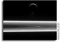 A Crescent Enceladus And Saturn's Rings