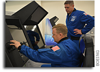 NASA Astronauts Get Advance Look at CST-100 Starliner Trainers