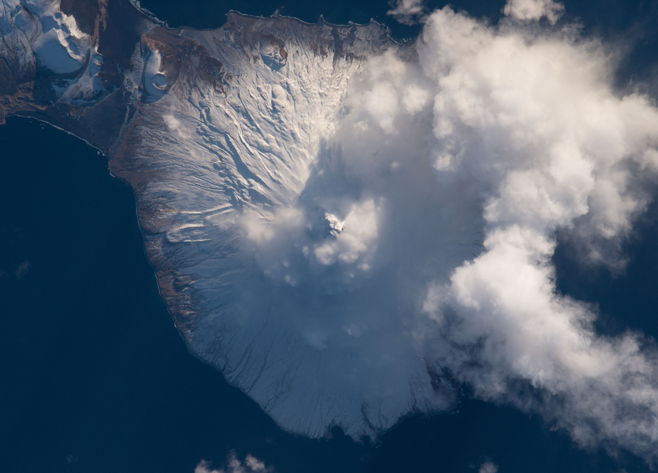 Volcano Steaming As Seen From Orbit