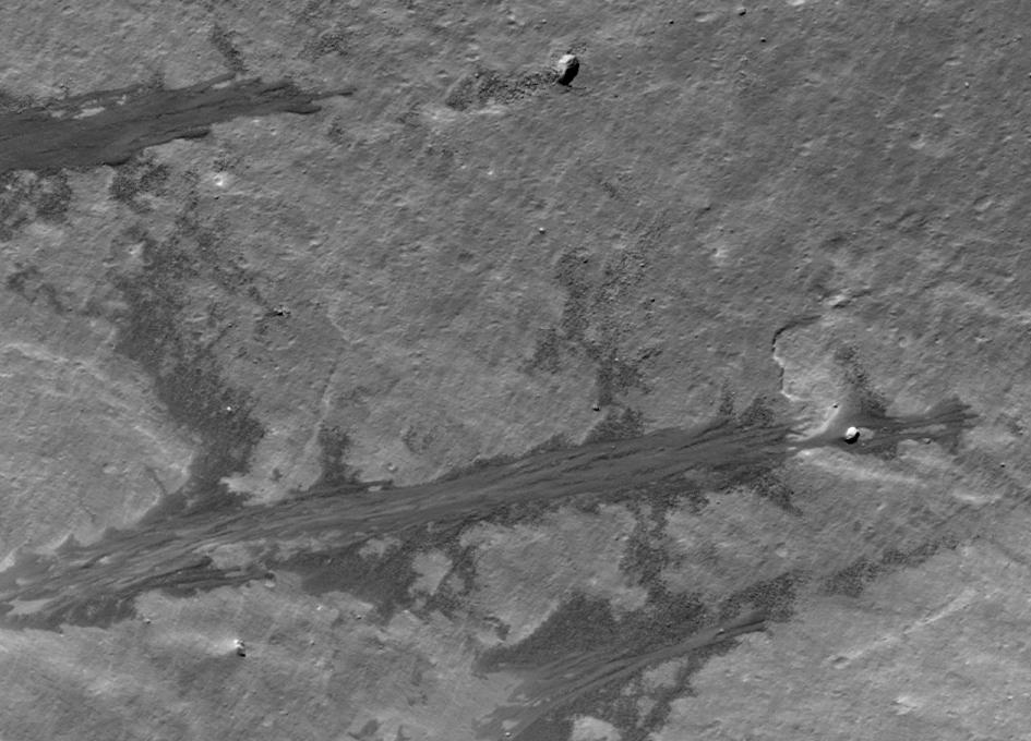 Dry Debris or Liquid Flow on The Moon?