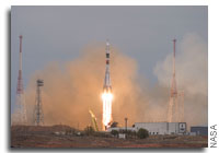 After Month Long Delay Soyuz Rocket Launches Astronauts to the International Space Station