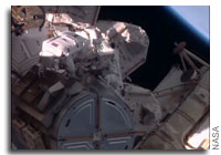 Astronauts Install New Docking Port for U.S. Commercial Crew Vehicles