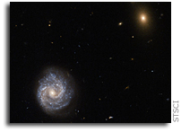 Hubble Views Powerful Galaxy Named 2XMM J143450.5+033843