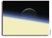 Enceladus Sets On Saturn's Horizon