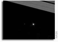 Cassini Sees Earth And Its Moon Between The Rings of Saturn