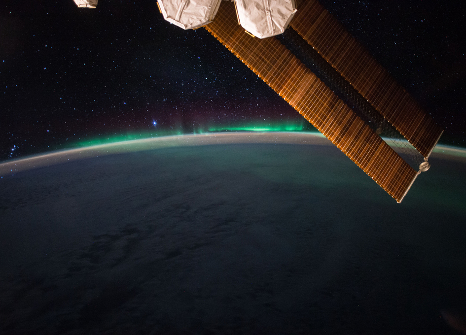 Aurora And A Starry Night Seen From Orbit
