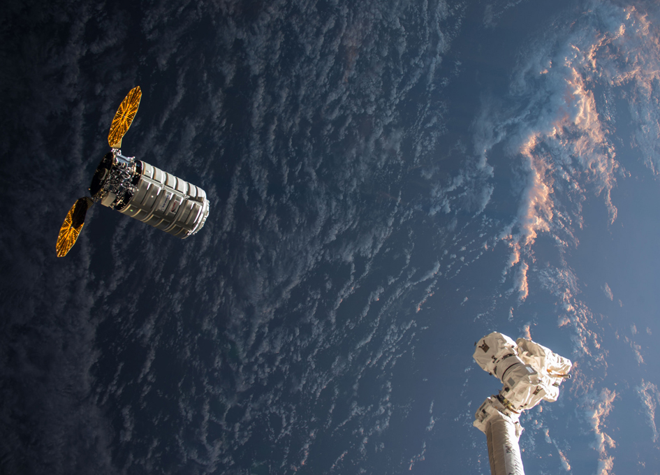 Cargo Droid Approaches ISS During An Orbital Sunrise