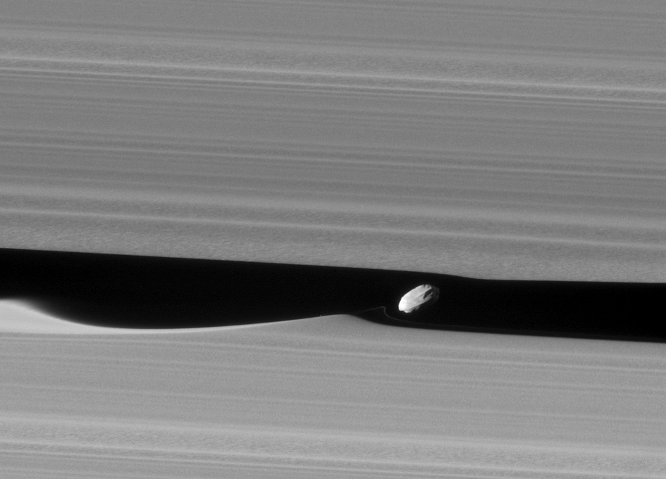 Close Up View Of Saturn's Moon Daphnis