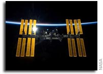 Stunning Backlit Image of the International Space Station
