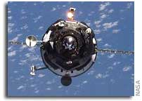 Progress Cargo Freighter Docks With ISS